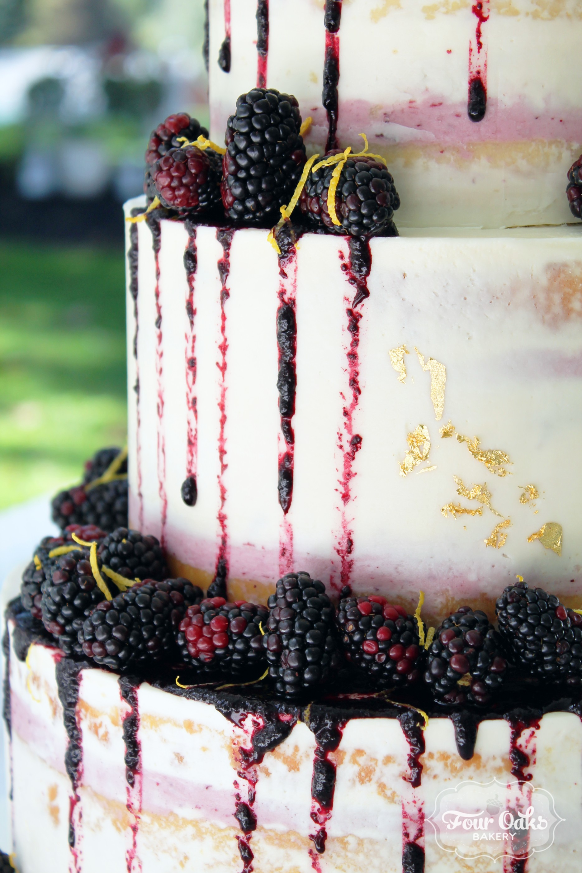 Lemon-Blackberry Semi-Naked Drip Wedding Cake in Delmont, PA
