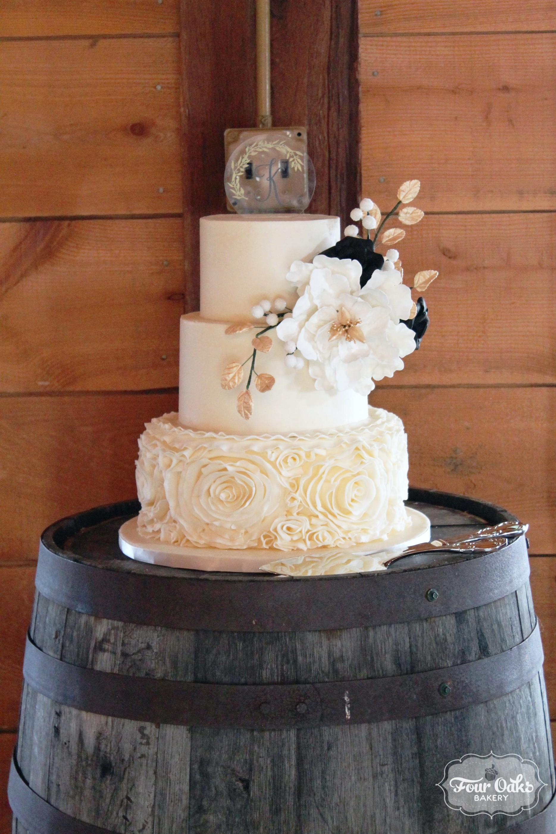 Black, Gold, and Ivory Wedding Cake - Four Oaks Bakery