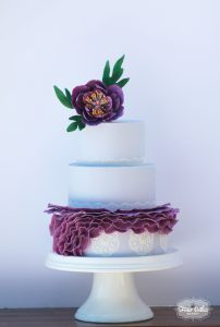 Purple ruffle wedding cake with purple gumpaste flower by Four Oaks Bakery in Pittsburgh, PA