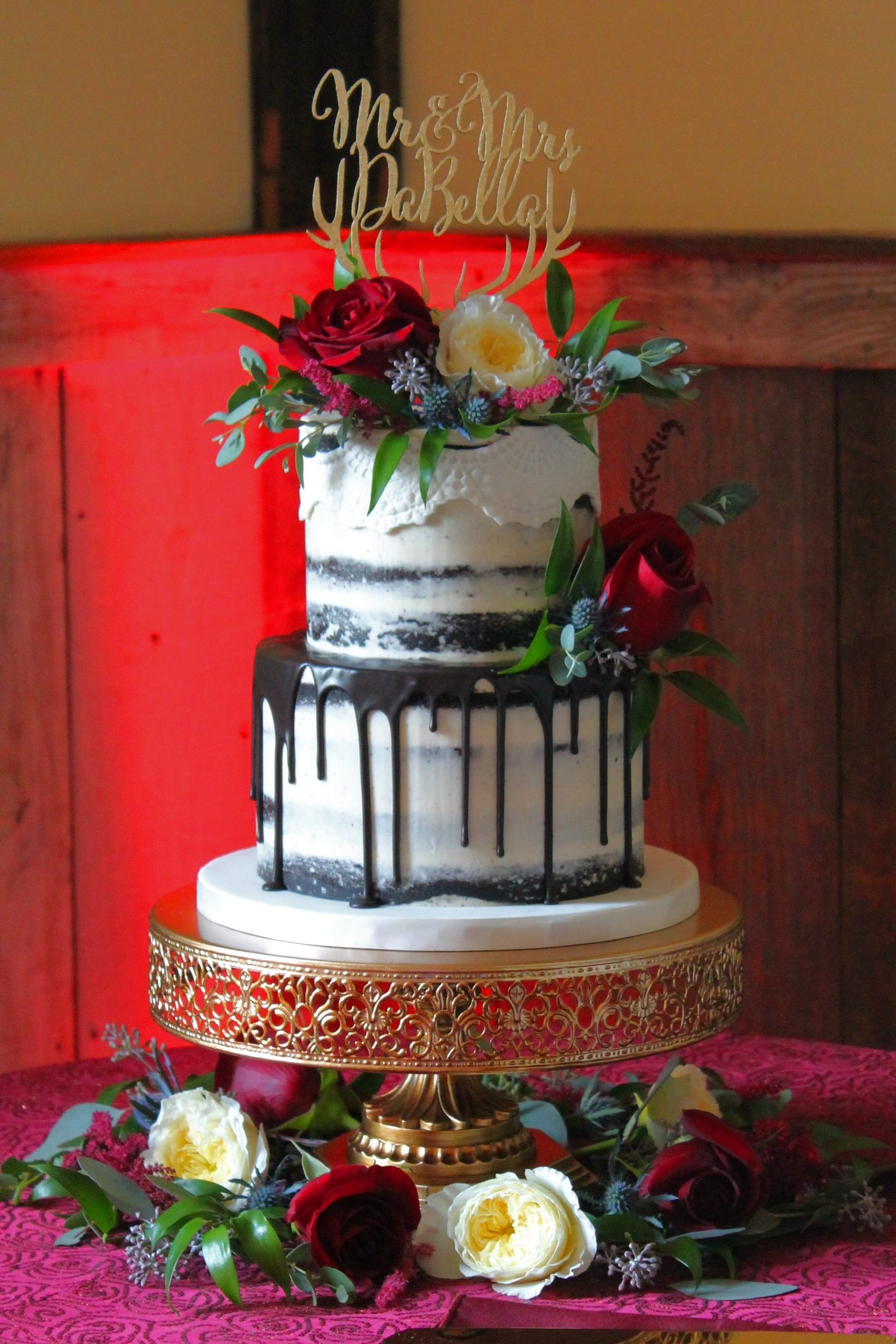 Chocolate Semi Naked Drip cake with fresh flowers from Four Oaks Bakery in Pittsburgh, PA